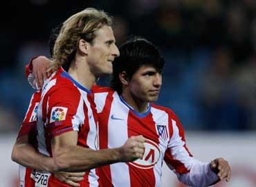 Forlán y Agüero dieron la victoria al Atlético de Madrid frente al Español