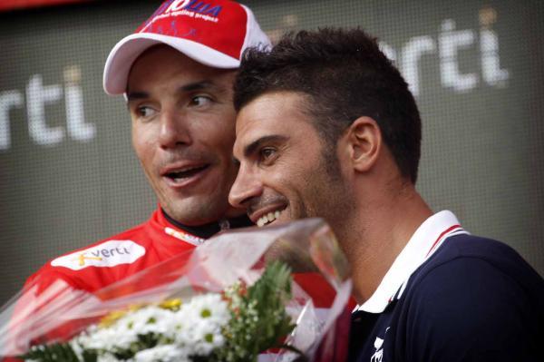 Joaquim Rodríguez en el podio con su ex compañero Óscar Pereiro