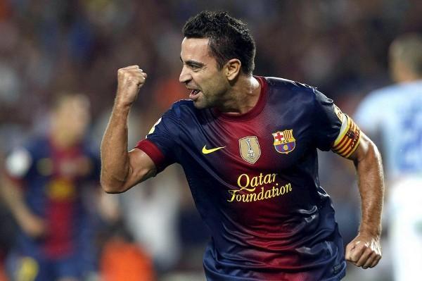 Xavi celebra con rabia su gol ante el Granada