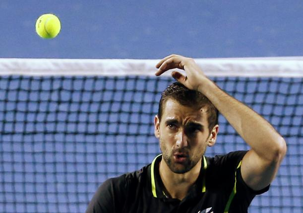 Croatia's Cilic reacts after missing a shot during his third round match against Spain's Bautista Agut at the Australian Open tennis tournament at Melbourne Park