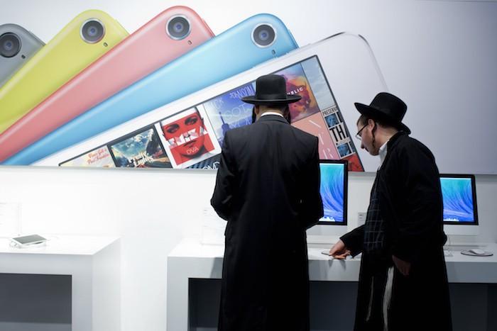 Ultra Orthodox jews shop at an Apple store in Jerusalem