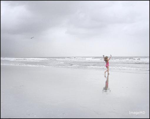 Fotografiaba menores en la playa en Málaga