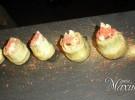 alcachofa confitada en Picual con almeja, jamon y polvo de oro