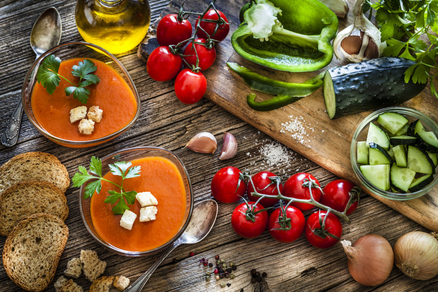 Spanish Gazpacho And Ingredients On Rustic Wooden Table