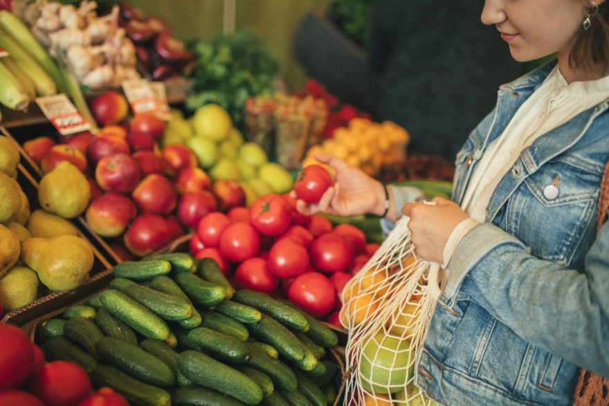 Young Girl Choosing Vegetables And Fruit At A Farmers Market With Reusable Bag, Plastic Free And Zero Waste Concept