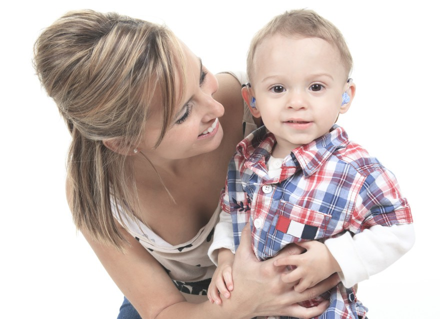 Mother with son. The kid have a Hearing Aids.